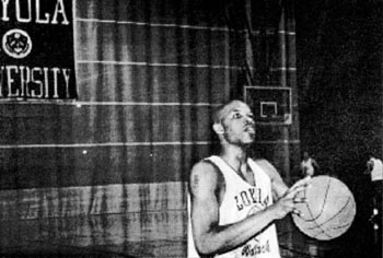 Brain Lumar, A'96, practices free throws in the Rec Plex during the 1994-95 season. The Wolfpack went on to compete in the national tournament.