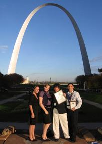 Senior staff writer Coleen O'Lear, Life & Times editor Nicole Wroten, sports editor Ramon Vargas and sports editor Michael Nissman display the Pacemaker Award under the Gateway Arch.