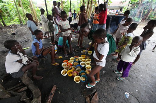 **ADVANCE FOR SUNDAY, OCT. 18** This Aug. 18, 2009 photo shows children accused of witchcraft waiting for food at the Childrens Rights and Rehabilitation Network in Eket, Nigeria. The idea of witchcraft is hardly new, but it has taken on new life recently partly because of a rapid growth in evangelical Christianity. Campaigners against the practice say around 15,000 children have been accused in two of Nigerias 36 states over the past decade and around 1,000 have been murdered.