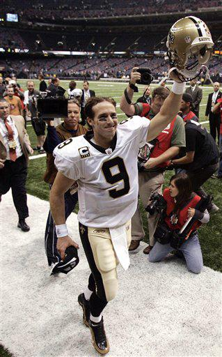 New Orleans Saints quarterback Drew Brees acknowledges fans after an NFL football game against the New York Giants in New Orleans, Sunday, Oct. 18, 2009. Brees insists its time to scrap the finesse label attached to the Saints. The Saints have been consistently outgaining teams on the ground and their defense keeps coming up big.