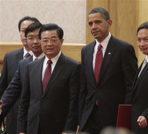 U.S. President Barack Obama, secon right, walks in with Chinese President Hu Jintao, third left, before their bilateral meeting at the Great Hall of the People in Beijing, China, Tuesday, Nov. 17, 2009.