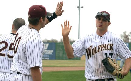 Wolfpack baseball players Lucas Wendt and David McChesney congratulate each other at the end of an inning. In the 2010 Gulf Coast Athletic Conference tournament, the team fell short of beating LSU-Shreveport.