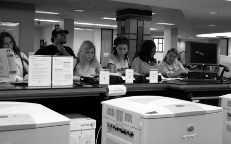 In an effort to conserve paper and ink, a new policy now forces students to have to wait for library attendants to sort through print-outs before retreiving their work.