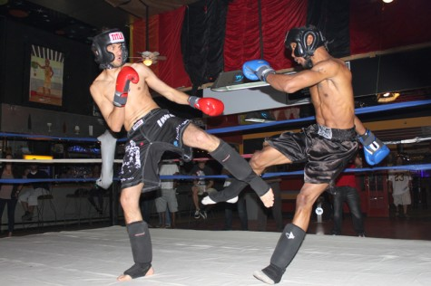 Nooh Hindi (left) and Devin Parker (right) face-off against one another at the Friday Night Fight, hosted at Marlene's Place.