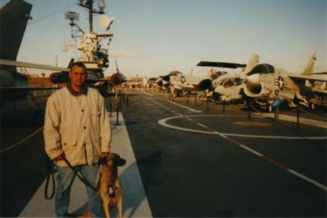 David Aviles stands with his dog Pasja on an aircraft carrier in New York. Aviles and Pasja helped in rescue efforts in the days after the collapse of the Twin Towers, and later helped the FBI track down hijackers.