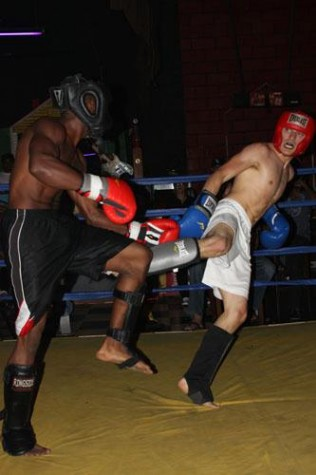 English writing sophomore Michael Sanchez face off against opponent Troy McGee at Marlene's Place Friday Sept.30. Sanchez has gone undefeated since kickboxing in March