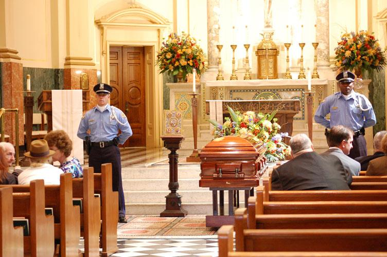 Guards+stand+near+the+coffin+of+Archbishop+Phillip+Hannan+at+Notre+Dame+Seminary.+Loyola+members+were+welome+to+view+the+body+along+with+the+rest+of+the+public+on+Oct.+4+and+5.