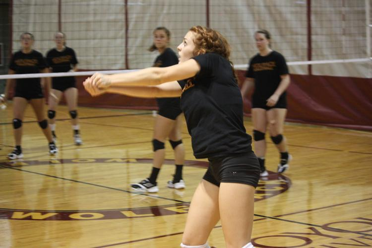 General+studies+freshman+and+defensive+specialist+Rachael+Lopez+bump+passes+during+a+full+set+practice+in+August.