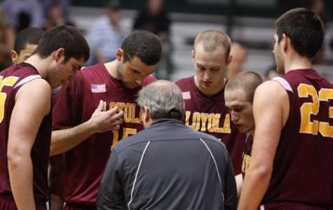 Team members huddle around head coach Michael Giorlando.