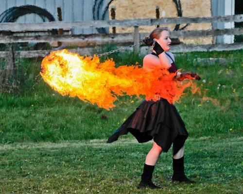 Danielle Latimer performs with a fire poi. Latimer first learned about fire performance in her hometown of Seattle.