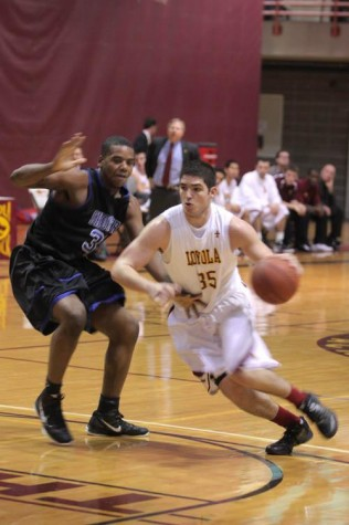 General Studies sophomore Robert Lovaglio battles it out during the Loyola game against Shorter University Friday Dec. 2. This was Loyola's first lost in The Den with a final score of 82-59.