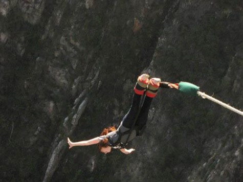 Maggie Copeland bungee jumps off the world's highest bungee jumping bridge in South Africa
