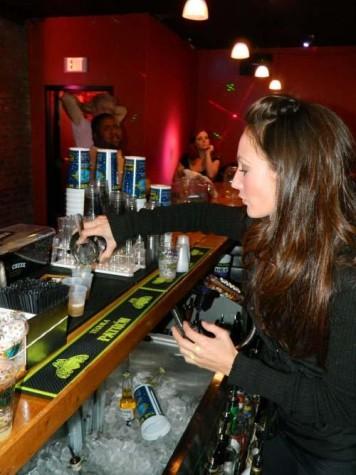 A bartender pours a drink at Krazy Korner. Krazy Korner offers interesting music and drink specials.