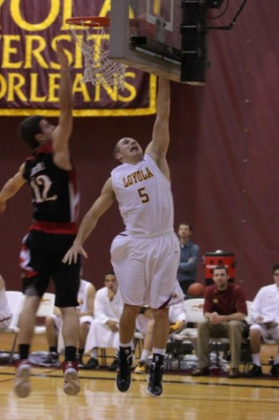 Corey Gray, biology senior and guard for the Loyola men's basketball team, scores a point against William Carry University.  Gray is on his way to breaking into the top 10 of all-time scorers for Loyola basketball.