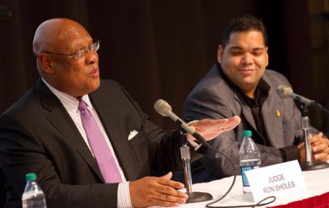 New Orleans judge Ron Sholes, left, speaks on a panel along with former State Rep. Juan LaFonta at the State of the Cit y forum in Nunemaker Hall Thursdae, March 1.