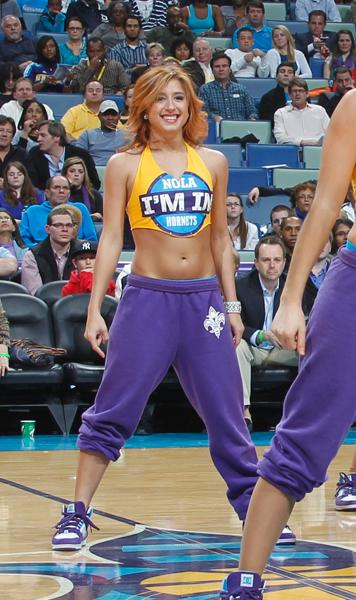 Lynn Kleinberger, psychology junior, performs as a Hornets Honeybee cheerleader at an event. Kleinberger juggles being a full-time student and her duties as a Hornets cheerleader.