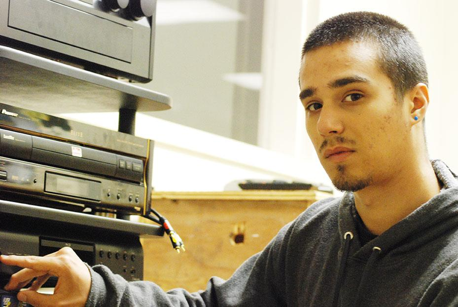 Philosophy sophomore Jake Silvas demonstrates how the Loyola's film buffs team sets up movies for students to watch.