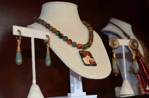 Owner Sarah Celino's handmade jewelry on display at Bella & Harlow. Using beads and pendants she finds around the city, Celino creates earrings and necklaces which she sells in the shop.