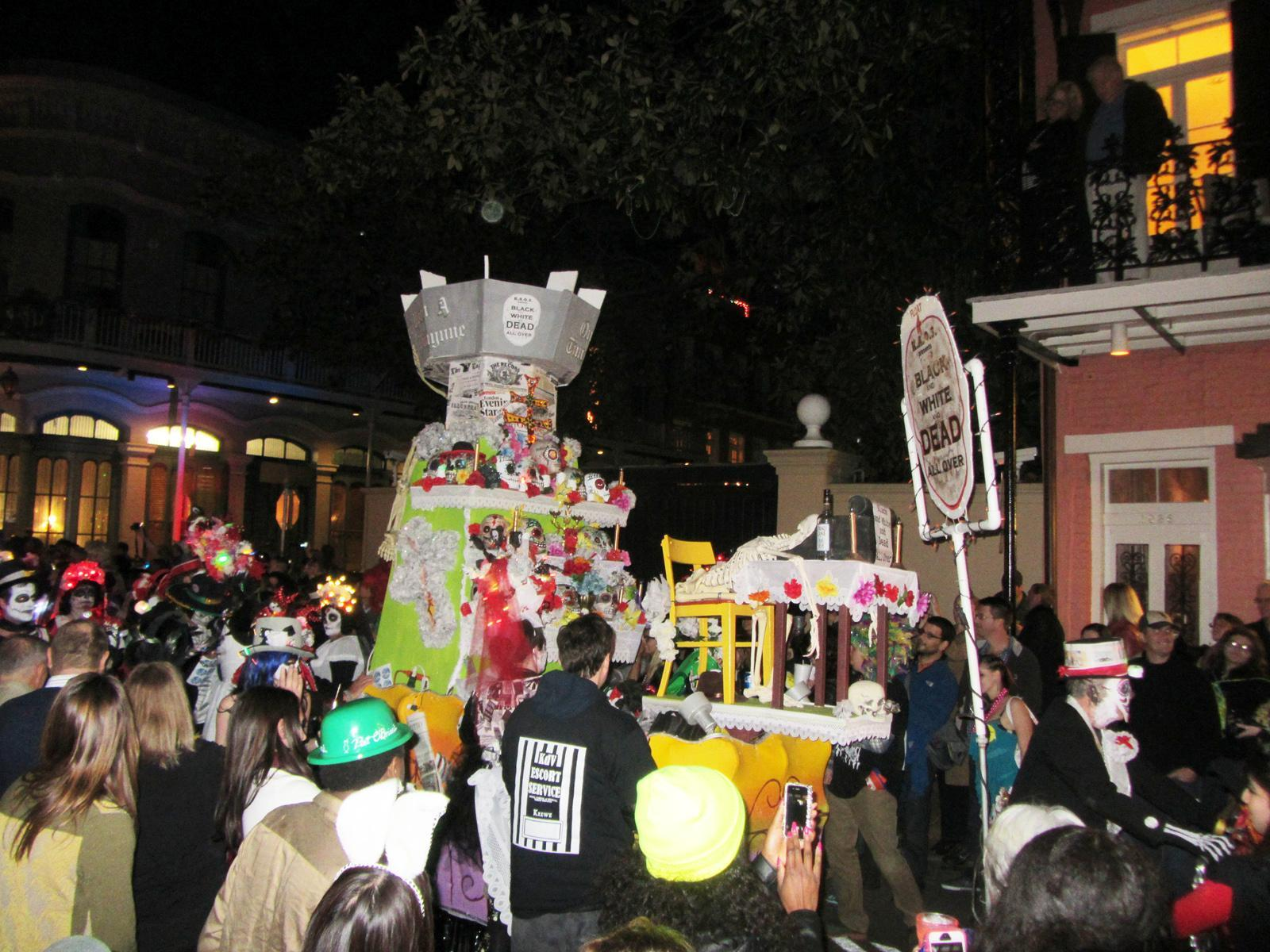 "Parade-goers surround a Krewe du Vieux float which criticizes the newspaper's recent decision to publish thrice weekly as opposed to daily. The float refers to the newspaper as ""The Times Prickayune"" while calling it ""Black and White and Dead All Over."