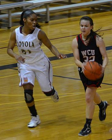 Sophomore Jeneicia Neely, 21, goes up against player from William Carey University in the game in The Den on Jan. 10. The Wolf Pack won the game with a score of 64-61.