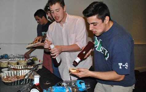 Phi Kappa Psi member Jordan Nabizadeh mingles with prospective members at their first round recruitment party on Jan. 25. Fraternities will admit new pledges next week.