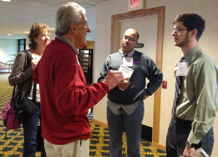 Philosophy senior Joshua Washington and philosophy sophomore Andrew Vincent discuss French philosophy with Professor Emeritus of philosophy at Denison University, Ronald Santoni. The American Philosophical Association conference hosted over 200 academic seminars and presentations by influential university educators.
