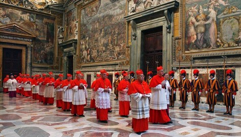 In this photo, taken on April 18, 2005 and released by the Vatican paper L'Osservatore Romano, cardinals walk in procession to the Sistine Chapel at the Vatican at the beginning of the conclave. This month's conclave to elect the 266th leader of the world's 1.2 billion Catholics will have all the trappings of papal elections past, with the added twist that this time around, the current pope is still very much alive.