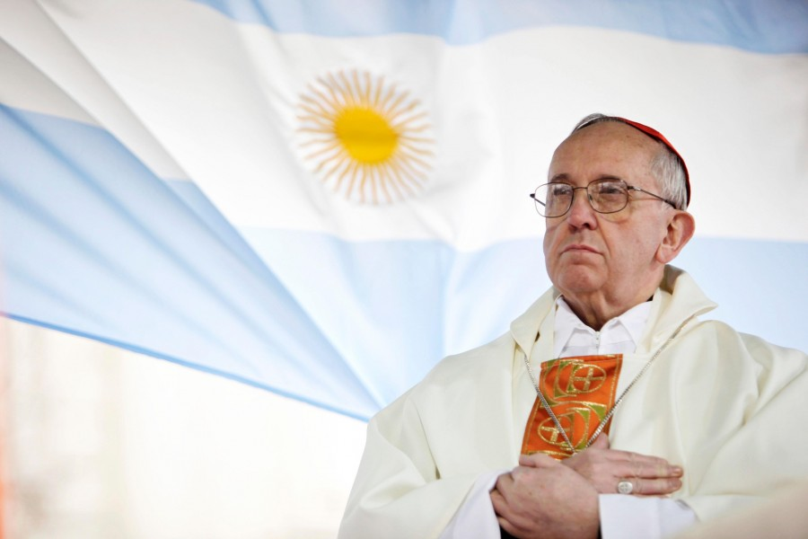 In+this+Aug.+7%2C+2009+file+photo%2C+Argentina%E2%80%99s+Cardinal+Jorge+Bergoglio+gives+a+Mass+outside+the+San+Cayetano+church+where+an+Argentine+flag+hangs+behind+him+in+Buenos+Aires%2C+Argentina.+On+Wednesday%2C+March+13%2C+2013%2C+Bergoglio+was+elected+pope%2C+the+first+ever+from+the+Americas+and+the+first+from+outside+Europe+in+more+than+a+millennium.+He+chose+the+name+Pope+Francis+I.