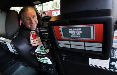 Simon Garber, owner of New Orleans Carriage Cab, poses inside a taxi cab with a backseat vending machine in New Orleans, Tuesday, March 19. New Orleans Carriage Cab launched backseat vending machines inside its 250-car fleet that also includes the Yellow-Checker Cab brands.