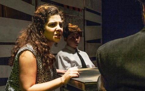 """Alina Gordillo, theatre arts sophomore, is interrogated by a police officer, jazz studies junior Miles Crabtree, in """"The Witness"""". The play is a one-act directed by theatre arts senior Rachel Christian and tells the story of the six Jesuits murdered in El Salvador by U.S. trained soldiers."""
