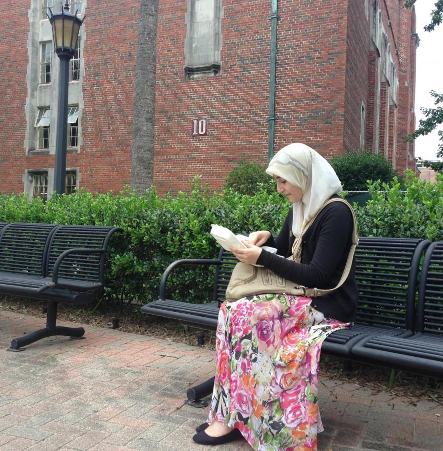 Farah Alkhafaf, psychology freshman, eats lunch during the Tuesday window. Alkhafaf is a Muslim originally from Iraq.