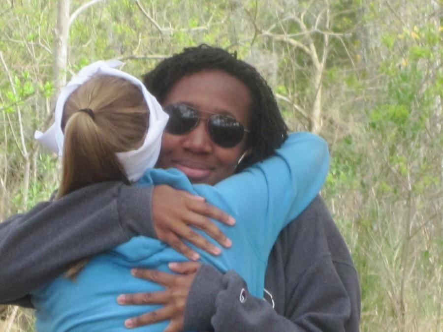 Carlyn+Worthy%2C+A%2712%2C+receives+a+hug+from+Michelle+Saint%2C+A%2713%2C+after+Worthy+gave+the+faith+talk+during+the+2012+Fall+Awakening+Retreat.++Loyola+students+have+attended+Awakening+for+more+than+a+decade.