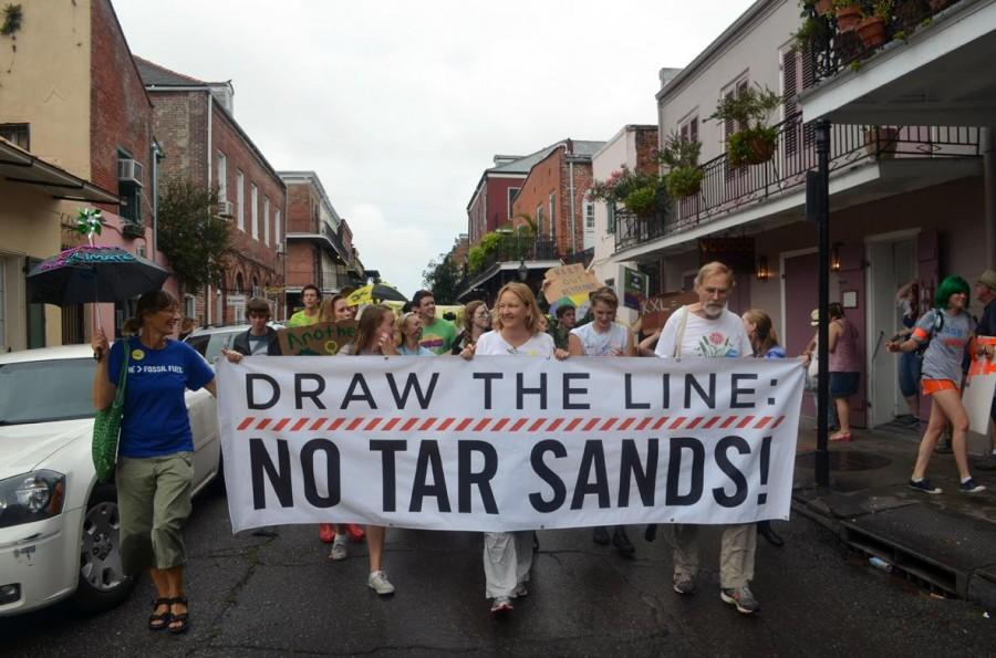 Protesters+march+through+the+French+Quarter+in+opposition+of+the+proposed+Keystone+XL+Pipeline+expansion.+Over+200+people+participated+in+the+second+line-style+protests.+