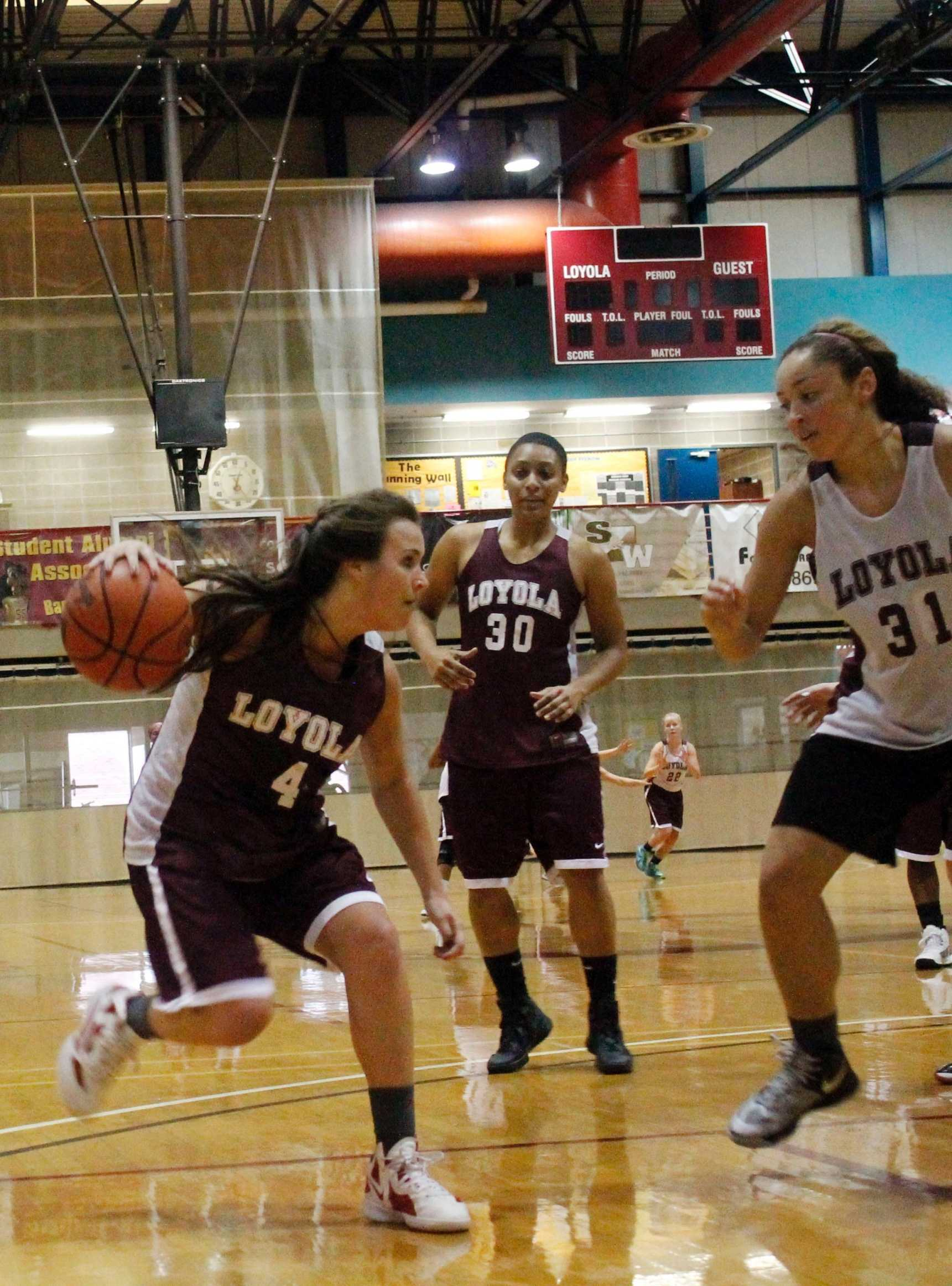 Accounting junior Megan Whittaker drives the lane at practicing with teammates Shayne Charles chemestry junior (30) and biology freshman Jackie Anderson (31) . Whittaker will play for Loyola this season  after playing two seasons with the Louisiana at Lafayette.