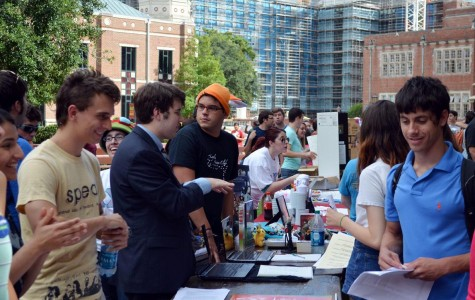 Students gather to discuss information about organizations. This event was hosted to recruit students to join groups.
