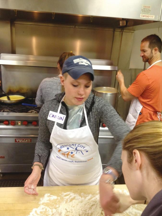 Caitlin+Vanderwolf%2C+English+writing+freshman+and+first-year+group+member%2C+helps+cook+breakfast+in+the+kitchen+at+Crescent+City+Cafe.+Vanderwolf+is+one+of+several+individuals+in+Loyola%E2%80%99s+Christian+Life+Communities+who+sought+to+strengthen+their+relationships+with+each+other+and+with+the+greater+New+Orleans+community+by+volunteering+at+Crescent+City+Cafe+on+Jan.+18.