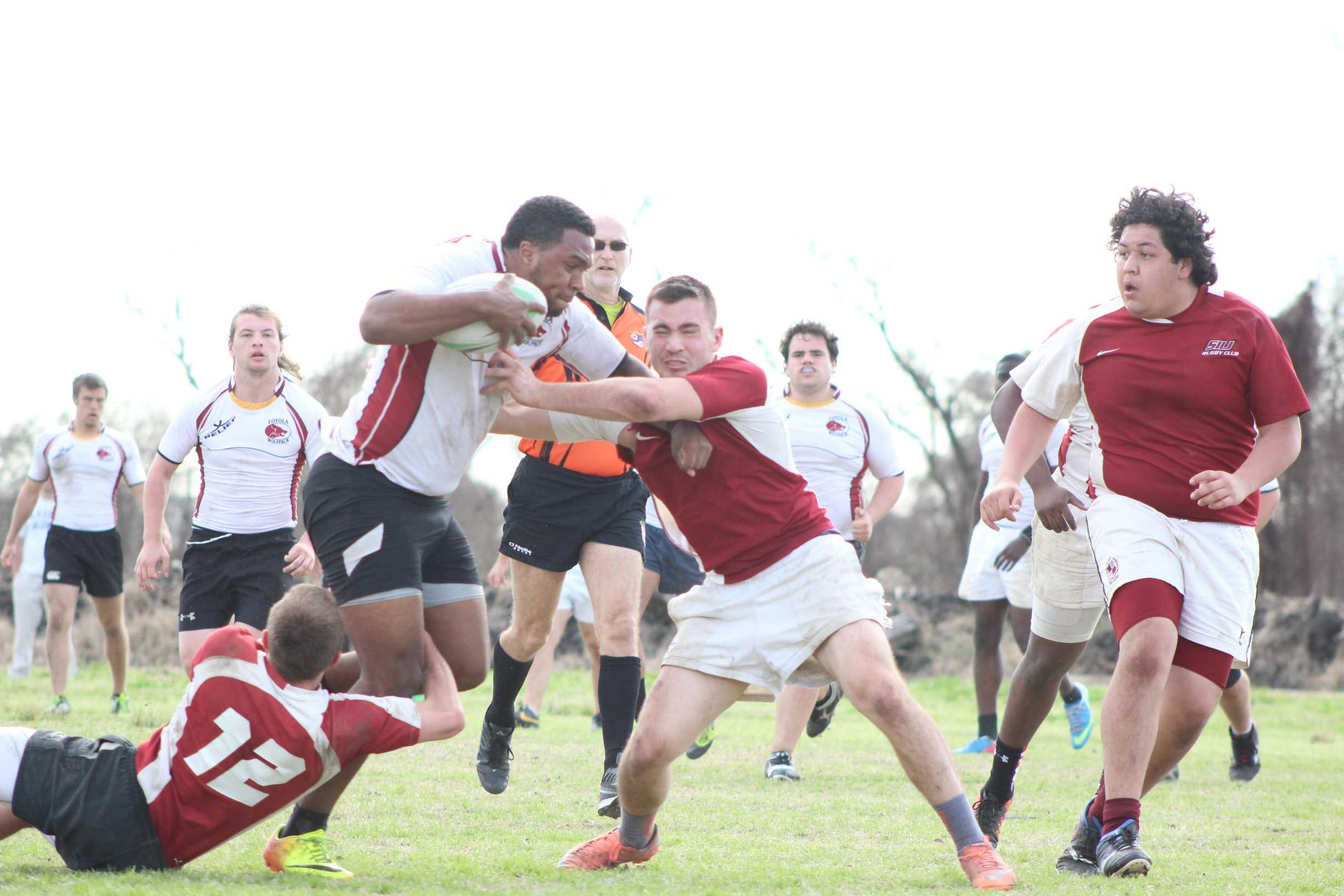 Shawn Maheia blocks a tackle against a defender from Southern Illinois. They won the weekend tournament put on by the New Orleans Rugby Football Club. The team travels to Florida for the second round of the tournament.