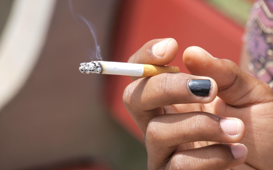 A+student+smokes+a+cigarette+on+Loyola%E2%80%99s+campus.+A+recent+initiative+has+resulted+in+a+complete+ban+of+tobacco+products+on+campus%2C+taking+effect+Aug+1.