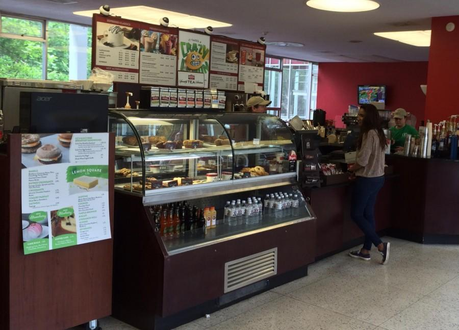 A student purchases a coffee at the CC's Danna Center kiosk. The location will soon be replaced by another coffee distributor.