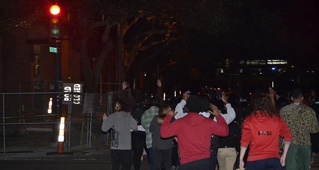 Protestors march across Freret Street.