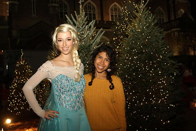 Kristen Herero, a marketing sophomore, poses with Elsa from Frozen.