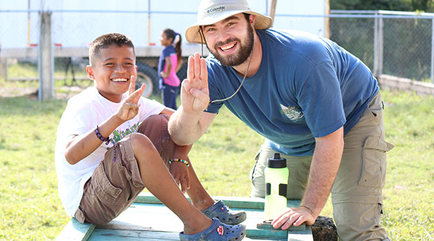 Jordan Platt, marketing junior, spends time with a Belizean boy. The baseball team takes this trip each winter break to not only serve the community, but also to teach baseball.