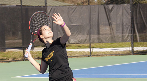 Alexa Mancuso, design sophomore, winds up for an overhead during the team's mid-day practice. The men's and women's teams are preparing to open the 2015 season under new head coach Kyle Russell.