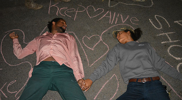 Mack Guillory (left), theatre arts sophomore, and another student participate in a die-in on Nov. 25, 2014. Loyola and Tulane students gathered and protested following the lack of an endictment in the Michael Brown case.