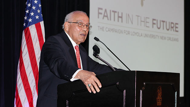 Norman Francis receives the St. Ives Award at the College of Law alumni luncheon.  Francis was the first African-American graduate of Loyola's College of Law and will serve as president of Xavier University until he retires at the end of this academic year.