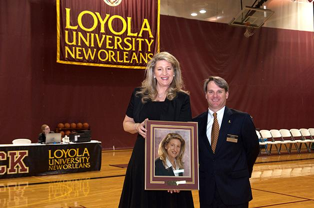 """Former women's basketball head coach Mary """"Dobee"""" Plaisance poses for her Hall of Fame photo with Brett Simpson, head athletic director (right). Plaisance led the women's team to their first conference tournament title in program history in the 2006-2007 season."""