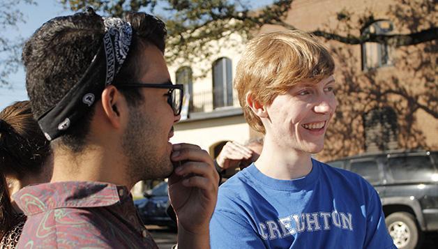 Edwin Unzalu, mass communication sophomore, and Jesse Kramme, a Creighton University student, talk on a street corner.