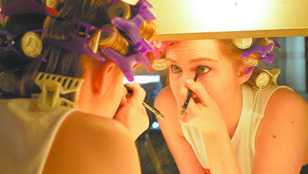 """Shelby Kirby, theatre arts and business junior, puts on her makeup and costume during a dress rehearsal for """"Crimes of the Heart.""""  The show opens on March 13 with a cast of actors who have put weeks of preparation into the production."""