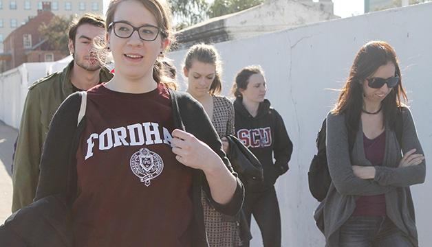 Students and administrators from Fordham University, Santa Clara University, Creighton University and Loyola University New Orleans walk outside St. Louis Cemetery #1.