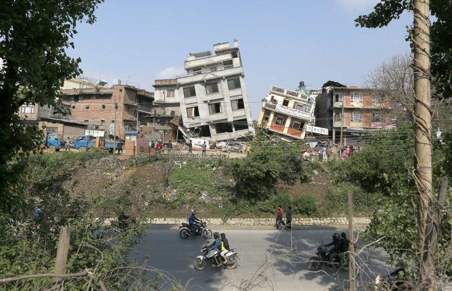 Damaged buildings lean to their sides in Kathmandu, Nepal, Monday, April 27, 2015. A strong magnitude 7.8 earthquake shook Nepals capital and the densely populated Kathmandu Valley on Saturday, causing extensive damage with toppled walls and collapsed buildings. (AP Photo/Wally Santana)